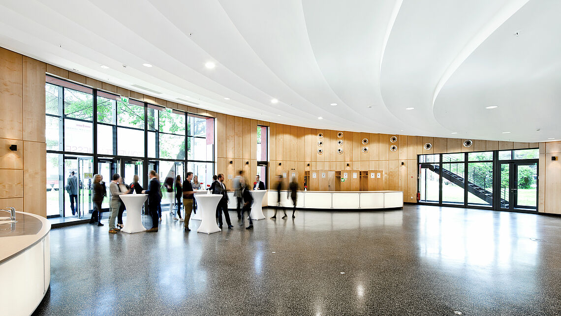 Ground Level: A view of the foyer and highly customizable reception space; a sink and service counter are located on the left edge of the image while the coat-check area is visible in the background